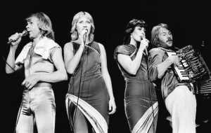 LONDON - NOVEMBER 9: Bjorn Ulvaeus, Agnetha Faltskog, Anni-Frid Lyngstad and Benny Andersson (playing accordion) of Abba perform on stage at Wembley Arena on November 9th 1979 in London. (Photo by Gus Stewart/Redferns)